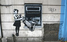 n May 2007, Banksy painted a cash machine with a menacing robotic arm onto a bricked up window in Exmouth Market in north London.