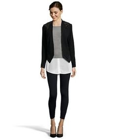 Ditch your basic blazer for an edgy-chic update with this embellished open blazer by the always glamorous, Haute Hippie.