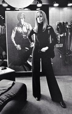 Betty Catroux wearing a jumpsuit in the Saint Laurent Rive Gauche boutique, rue de Tournon for Vogue Paris February 1969