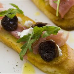 Try this Prosciutto Crostini with Dried Cherries and Goat Cheese recipe by Chef Curtis Stone. This recipe is from the show Chefs Christmas 2009.