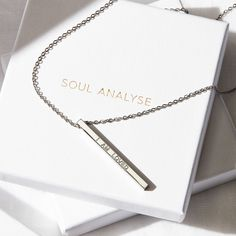 Styled product photography UK. Hard lighting, shadows, jewellery, necklace, white boxes. This image is copyright of Sally Williams Photography © 2021 all rights reserved. Photography Uk, Product Photography, Sally, Shadows, Arrow Necklace, Boxes, Jewellery, Lighting, Image