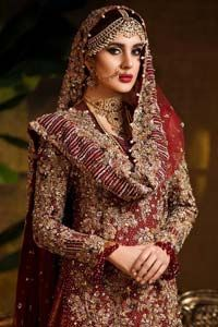 Captured in traditional silhouette. The bridal stands out due to its uniqueness and the perfect fusion of modern cut and traditional embroidery. This dress is beautifully highlighted with zardozi work in the shades of tan and silver. The hemline of the shirt is adorned with scalloped finishing and tassels on the sleeves. It comes with […] The post Pakistani Wedding Wear – Maroon Shirt Banarsi Gharara appeared first on Latest Pakistani Fashion 2020 - Formal Wear - Anarkali - Party Clo