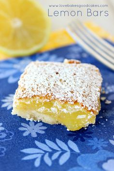 The best LEMON BARS ever - with their buttery crust and yummy lemony filling, they're sure to become a family favorite!  #lemon #Spring #des...