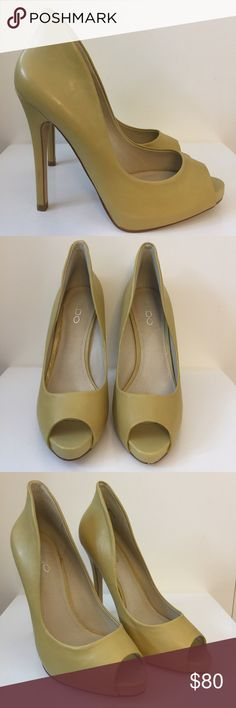 Aldo leather peep toe pumps Yellow Aldo leather peep toe pumps with high back. New without tags, never worn. Aldo sizing 38 Aldo Shoes Heels
