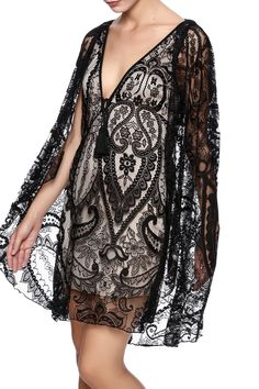 Sheer black lace dress with a v-neckline, deep v-neckline, lace cape overlay and full nude lining.   Lace Cape Dress by Symphony. Clothing - Dresses - Lace New York City