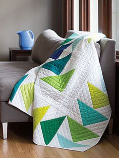 Use pre-cut triangles to make this quilt, Round Trip. Intermediate quilting project with accompanying tutorial available.