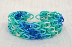 Rainbow Loom bracelet made from rubber bands in ocean colors. teal, light blue, blue, dark blue,and white.
