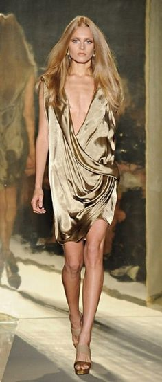Donna Karan- This dress would look better on me, because I actually still have curves.
