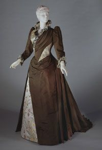 Woman's Dress: Bodice with Attached Overskirt, Dickey, and Skirt    Made in France, Europe  c. 1889-91    Designed by John Redfern & Sons, Paris, 1881 - 1892    Silk warp-faced plain weave, silk satin with brocading, ostrich feathers