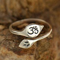 This is a beautifully etched adjustable 925 sterling silver ring featuring the symbols of Ohm and Lotus. It's a perfect gift for the special woman in your life! It is adjustable and starts at size 7.