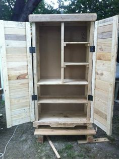Love this armoire!! Made by Austin's pallet furniture. You can find him & his awesome creations on Facebook.