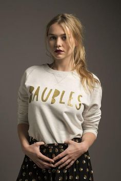 A off-white & gold Baubles jumper from the Save The Children & Selfish Mother Christmas Jumper Day charity collaboration, as worn by Immy Waterhouse