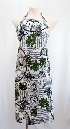 This designer apron is not only for Christmas time, the mistletoe design gives the cook that wears this apron unlimited kisses on demand thanks to the mistletoe cunningly hidden in the design! This is a really lovely print in crisp white with black sheet music, clocks and wrought iron images. And the subtle green mistletoe with red berry lift the whole design to a new level of coolness. The size is approximately 70 x 90cm and this is a quality cotton fabric. Available from Gorgeous… Gifts For Pet Lovers, Gifts For Mum, Gifts For Women, Great Gifts, Apron Designs, Floral Scarf, Knitting Accessories, Mistletoe, Online Gifts