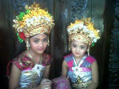 Nanda & Tata dressed for a temple ceremony. Read more about Bali at http://www.ninadesigns.com/bali_bead_info/bali_history.html