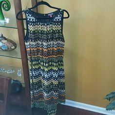 Dress Vibrant Multicolored Dress, short in the front and long in the back.  It's pleather  trimmed around the arms and neck.  Peep hole in the back with small gold button.  Worn once!!!!! Vince Camuto Dresses
