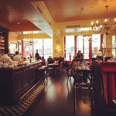 At Café Rouge where I was a good little tourist and sipped tea whilst writing on overpriced postcards