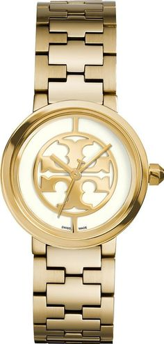 reva watch, gold toneivory, 28 mm. TFeaturing a bold, gold tone stainless steel bracelet, it has brushed T shaped links and an octagonal crown for a subtle signature geometric touch. A butterfly closure keeps it secure and comfortable around the wrist. #ToryBurch #GoldToneWhite #Watches #ToryBurch #Women #fashion #obsessory #fashion #lifestyle #style #myobsession #stylish #luxury #luxuryfashion #watches #accessories #dresstoimpress