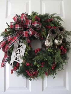 Christmas Wreath, XL Front Door Wreath, Natural Winter Wreath, Evergreen Wreath, Holiday Wreath, Ice Skates, Sled, Christmas Decoration by FunFlorals on Etsy https://www.etsy.com/listing/477898312/christmas-wreath-xl-front-door-wreath
