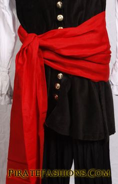 She be wearing a Seamen's Pirate Sash in burgundy fer $20.  Made of 100% Linen fabric which be 3 times stronger that cotton.  Comes in 7 colors: Autumn Gold, Crimson Red, Real Blue, Royal Burgundy, Forest Green, Rogue Brown n' Pirate Black.  Ye should tried to match the sash color with the bandana color.