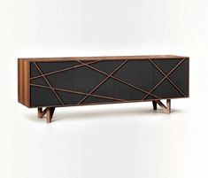 Terry Zappa and Marconato Maurizio Brave Cabinet - Brave is a high end and structured console. In break with the beautiful and wide panels of the massive wood, exclusive lines collide in a disordered way to bring a contemporary dynamism to the furniture.