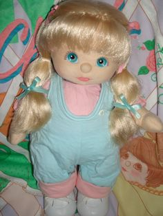 Euro My Child Doll  ---  British Ultra Long Blonde with Aqua Blue eyes, Pink lips and Grey eyeshadow. Wearing: Original Aqua Romper with pink shirt, Original HTF Pink stripped Oxfords and multi-color stripped socks with lace.