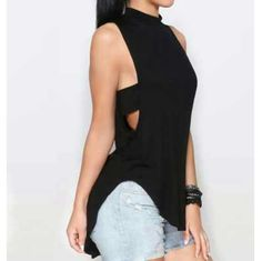 Cutout tank top Black cutout asymmetrical tank top, sizes small, medium, and large in stock. Shipping for this item takes up to 2 weeks 4dclothingshop Tops Tank Tops
