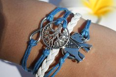Handmade Blue and White Leather, Rope, Charm Bracelet ~ Friendship Bracelets ~ Multilayer ~ Elephant, Tree of Life, and Infinity Charms ~ A6 by BraceletHutUSA on Etsy https://www.etsy.com/listing/226736014/handmade-blue-and-white-leather-rope