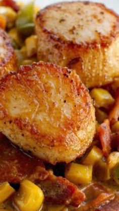 Seared Scallops with Creamy Bacon Corn Sauce ~ Perfectly Seared Scallops are served over a Cajun-seasoned Creamy Bacon Corn Sauce to make this fresh and flavorful dish.