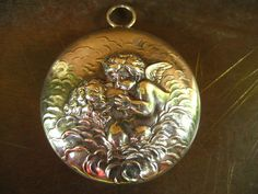 """ULTRA RARE Unger Brothers chatelaine sterling compact """"Love's Dream"""" cherub kissing nude woman on Etsy $720 from HouseOfRene with Free Shipping Worldwide"""