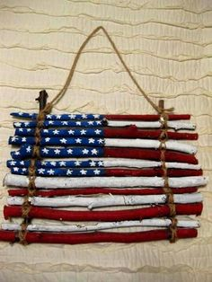 Twigs/ sticks + yarn/string + paint = Old Glory ! (even try different stick sizes and lengths)