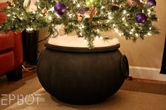 Harry Potter-themed Christmas tree - Plant Your Christmas Tree In a Potter-Inspired Tree Cauldron! Harry Potter-themed Christmas tree - Plant Your Christmas Tree In a Potter-Inspired Tree Cauldron! Deco Noel Harry Potter, Harry Potter Navidad, Harry Potter Weihnachten, Décoration Harry Potter, Harry Potter Christmas Decorations, Harry Potter Christmas Tree, Hogwarts Christmas, Halloween Decorations, Halloween Christmas Tree