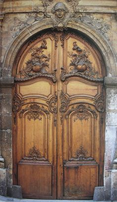 Rue Moniseur-le-Prince. Incredible carved doors!! Can't find any add info. They're  listed as interior doors?!! notice stone block at the bottom of each door, it would appear that the doors can only open in one direction