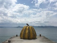 The famous yellow pumpkin sculpture by renowned Japanese artist Yayoi Kusama. The island is known as 'art island' for its outdoor installations and art galleries, Naoshima Island, Japan