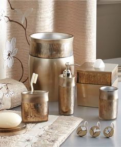 How to Decorate Your Home Using Your Wedding Registry | With all the decorations, it's easy to overlook the smaller essentials like bathroom accessories. Decorative towels, soap dispensers, shower curtains and rugs are just a few must-haves you won't want to forget.