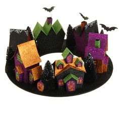 "The Jolly Christmas Shop - Raz 16"" Lighted Wraparound Halloween Village Houses H3416418, $39.00 (http://www.thejollychristmasshop.com/raz-16-lighted-wraparound-halloween-village-houses-h3416418/)"
