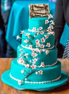 Let love blossom. Lovely wedding cake with handmade sugarflowers and the wedding invitation in chocolate.