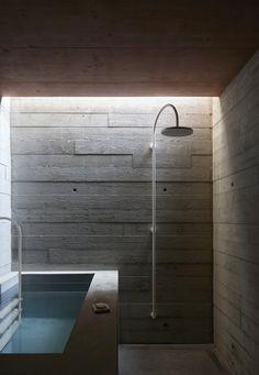 Rothaus | Jonathan Tuckey Design, Andermatt, Switzerland. A board-marked concrete plunge pool & shower.