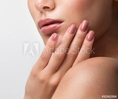 Beautiful Young Woman with Clean Fresh Skin. Close up Portrait.