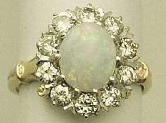 A very fine and impressive vintage opal and 0.80 carat diamond antique style dress ring in 18 carat yellow gold and platinum; part of the AC Silver vintage jewellery / estate jewelry collections    http://www.acsilver.co.uk/shop/pc/0-80-ct-Diamond-and-Opal-18-ct-Yellow-Gold-Dress-Ring-Vintage-Circa-1960-171p3775.htm