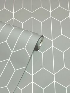 This stylish Linear Geo Wallpaper will make a great feature in your home with it's simple yet effective geometric design. The delicate linear pattern forms interlocking hexagonal shapes in pale grey on a soft mid grey backdrop, with a smooth matte finish. Easy to apply, this high quality wallpaper will look great when used to decorate a whole room or to create a distinctive feature wall. Geometric Wallpaper Grey, Geo Wallpaper, Wallpaper Paste, Adhesive Wallpaper, Linear Pattern, Hexagon Pattern, Pattern Matching, High Quality Wallpapers, Geometric Designs