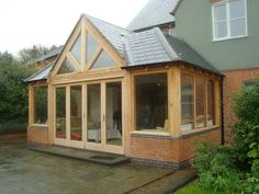 Redefine your living space! For made-to-measure timber products or the installation of an orangery or sunroom, call Trustwood Joinery Manufacturers Ltd in Leicester or email us to discuss your requirements. Orangerie Extension, Porch Extension, Brick Extension, House Extension Design, Extension Designs, Glass Extension, Rear Extension, House Design, Extension Ideas
