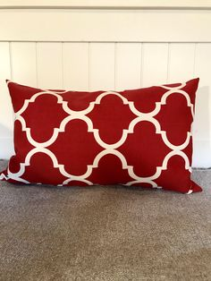 A personal favorite from my Etsy shop https://www.etsy.com/listing/555032192/red-moraccan-quatrefoil-lumbar-pillow