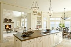 Very pretty---especially lanterns, stone floors, and wood top island! A seamless transition to living room!