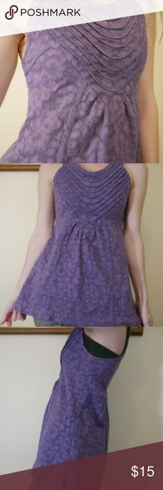 Free People Purple Lace Razor Back Tank Tunic Fair condition. Cool front bust layers. Underarm has fading - I was always going to re-Tye dye it with purple dye. But have decided to just sell. Fits so cozy and snug. Stretchy. Babydoll. Lavender. Made in Vietnam. Sorry about the blurry pictures I am learning a new camera. Free People Tops Tank Tops