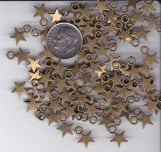 YOU GET 100 BRONZE TONE METAL STAR CHARMS. -  FROM JUNKMANRALF  U.S. SELLER  - W #Unbranded