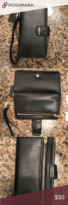 "COACH cell phone wrislet/wallet (black) 100% authentic, Coach IPhone 6 wristlet/wallet, like new! 3.5"" wide, 6"" height. Black, polished leather. No scratches or stains! Holds 5 cards, cell phone and moola! Button fastener is very secure! If you have a different brand of phone, you'll have to measure I do not know what other cell phones will fit besides the iPhone 6 but I'm sure there's plenty! Coach Bags Clutches & Wristlets"