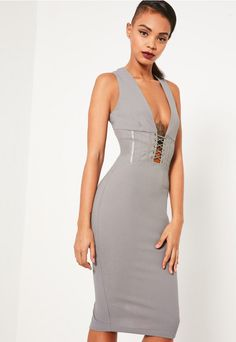 We're crushing over corset deets this season and this grey crepe dress is at the top of our lust have list with its plunging neckline and lace elements.