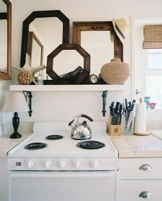 If you have room above your stove, consider installing a small shelf. Instead of displaying tabletop pieces though, use it as an excuse to create a stylish vignette. It will change the way you look at your kitchen. Source: Lonny Magazine