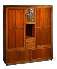 Fine Vienna Secession Armoire Vienna, c. 1903 Chased copper relief of Goethe by Georg Klimt Mahogany veneer with parquetry border Illinois, Armoire, Koloman Moser, Vienna Secession, Chicago, Parquetry, Klimt, Antique Furniture, Closets
