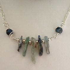 "Raw Gemstone Necklace Crystal and Gemstone Lovers One of a Kind!⭐️ Raw Blue and Green Kyanite Gemstone Blades with Sterling Silver Beads between! Blue WireWrapped Kyanite bead attaches to Sterling Silver Plated Chain! Length can be Custom and would look Either Short or on a longer chain. Gemstone Focal is 2 1/4"" Jewelry Necklaces"